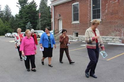 Joni Luna, center in blue, walks with Sisters Marsha Speth, Mary Beth Klingel, Editha Ben, Dawn Tomaszewski, and me after entering the Sisters of Providence postulancy.