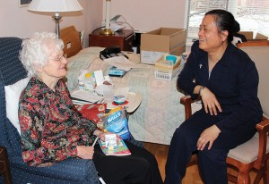 As part of her ministry with the Ministry of Care team, Sister Su-Hsin Huang visits with Sister Dorothy Hucksoll as the two unpack and get Sister Dorothy settled into a new room at Providence Health Care.