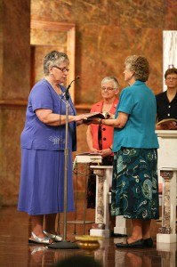 Sister Laura Parker professes perpetual vows as a Sister of Providence at a ceremony on June 30, 2013 at Saint Mary-of-the-Woods, Ind. Sister Jenny Howard holds the Bible as General Superior Denise Wilkinson and Sister Dawn Tomaszewski look on.