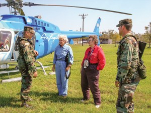 Sister Helen Vinton in blue, is out and about in her ministry in Louisiana. Here she prepares to do damage assessment by helicopter to remote rural coastal areas after Hurricane Katrina (Submitted photo).