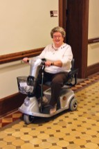 Sister Kay Kelly gets around well in her motorized wheelchair.