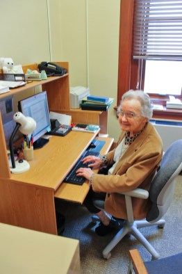 Sister Noralee Keefe works on a Word document in her office.