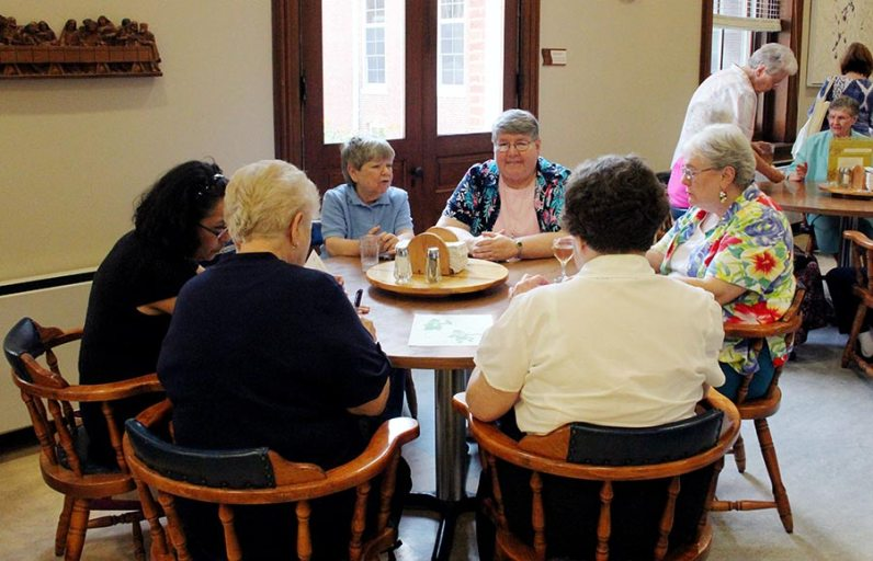 Two Sister Cathy's. Sisters Cathy Campbell and Cathy White with Sister Marie McCarthy chat with others gathered at the Sunday social.
