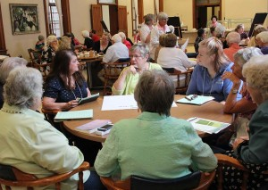 Providence Associate Jude Magers, center rear, joins a table discussion during this year's Providence Associates annual meeting. Associates on either side of Jude are Judy Barad to Jude's right and Diane Weidenbenner to her left.