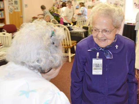 Sister Joanne Cullins greets a visitor.