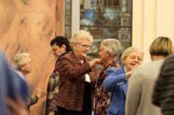 Sister Lisa Stallings pins the Providence Associate pin on her Providence Associate Companion Traci Tucker.