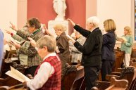 Sisters of Providence Companions extend their arms in blessing over the new Providence Associates.