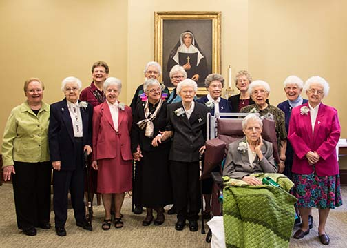 Several Sisters of Providence celebrated Jubilees in December. They were honored at a celebration with the Sisters of Providence General Council. The sisters celebrating Jubilees included (front, seated) Sister Ann Jeanette Gootee, (second row) General Council member Sister Mary Beth Klingel, Sisters Mildred Giesler and Kathryn Koressel, General Superior Sister Denise Wilkinson, and Sisters Dorothy Hucksoll, Miriam Clare Stoll, Marie Victoria Podesta, Florence Norton and Kathleen Mary Gay, (back) General Council member Sister Dawn Tomaszewski, Sister Anne Krause, and General Council members Sister Lisa Stallings and Sister Jenny Howard.