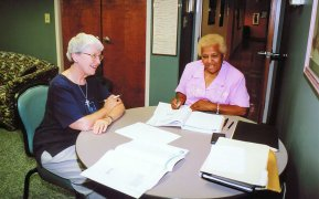 Sister Margaret Quinlan tutors an adult in 2005 from a Terre Haute, Indiana, service agency.