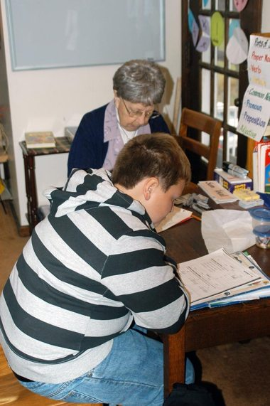 Sister Ruth Sampson (RIP) tutors a student after school in 2011
