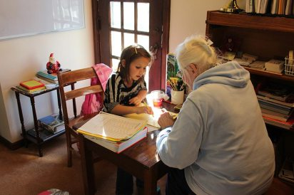 Sister Charles Van Hoy tutors a little girl in 2012.
