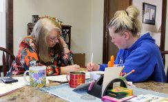 EFS Director Penny Sullivan works with an adult student in 2013.