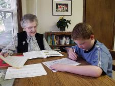Sister Frances Joan Baker (RIP) tutors a young man after school at EFS in 2005.