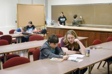 Saint Mary-of-the-Woods College students volunteer helping Educational/Family Services' students after school in the College's Hulman Hall in 2011.