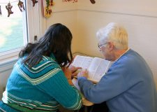 Sister Joseph Fillenwarth still busy helping her same student with her homework a year later in 2012.