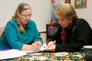 Educational/Family Services Director Penny Sullivan works with an adult student in 2008.