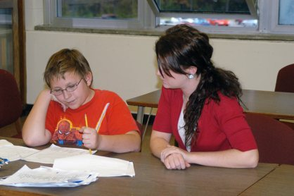 A Saint Mary-of-the-Woods College student volunteers in 2011 to help a boy with his homework after school.