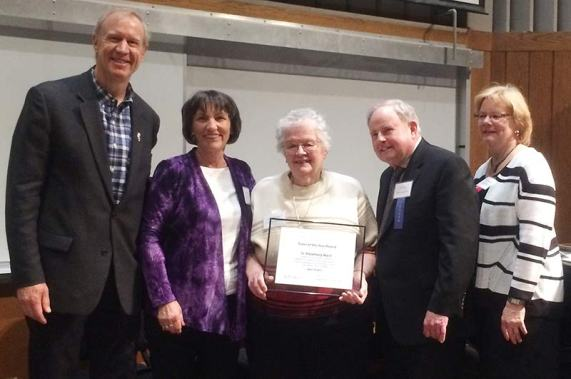 Illinois Gov. Bruce Rauner (from left), and Schools and Tutors on Wheels director Deborah Bradt pose with Sister Rosemary Ward (center) after she was handed the Outstanding Tutor of the Year award on April 18. Also on hand were John McLeod (next to Sister Rosemary Ward) and Maureen Meehan.