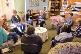 Inside White Violet Center for Eco-Justice, participants in Bread Rising, Spirit Raising one-day retreat focus on the Divine.