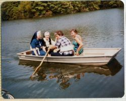 A boat ride during the 1981 infirmary picnic to the lake. From left clockwise: Sisters Marie Patrice Cleary, Ann O'Hara, Luke Crawford and Cathy Buster.
