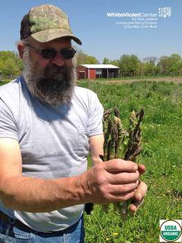 Gotta love organic asparagus! We know assistant garden manager Dave does.