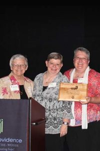 Saint Mary-of-the-Woods residents Stacy Pierce (center) and Penny Frederick (right) accepted the Sarah and Joseph Thralls award from Sisters of Providence General Superior Sister Denise Wilkinson during the Saint Mother Theodore Guerin Dinner, which took place on Saturday, June 6, at Saint Mary-of-the-Woods.