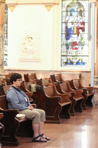 Sister Carole Kimes in quiet prayer in the Church of the Immaculate Conception at Saint Mary-of-the-Woods, Indiana.