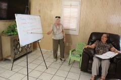 Hard at work, Sister Carol Nolan helps Rufina Martinez improve her English.
