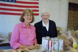 Sister Florence Norton (right) and a volunteer at Providence Food Pantry.