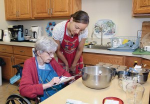 Sister of Providence of 71 years Sister Ann Kevin O'Connor helps Novice Sister Tracey Horan improve her baking skills.