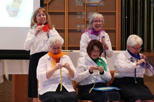 """2015: Providence Associates (front, from left) Sheila Donis, Sharon Michaud, Diann Neu, (back) Mel Wolff and Donna Kehoe performing in """"To God Through Music"""""""