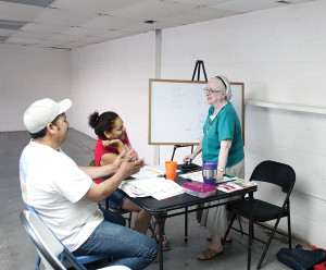 Sister Loretta, at right, teaches English to adult students in Thermal, California, as part of her ministry with Providence in the Desert.