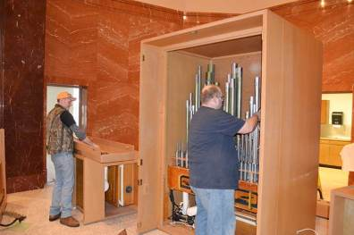 Employees from Wicks Organ Company tearing down the organ in Saint Joseph Chapel.