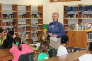 Sister Barbara Battista meeting with students at St. Patrick School.
