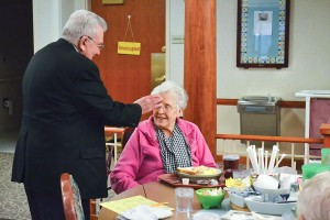 Father Dan blesses Sister Mary Patricia Cummings (formerly Sister Marie Janice).