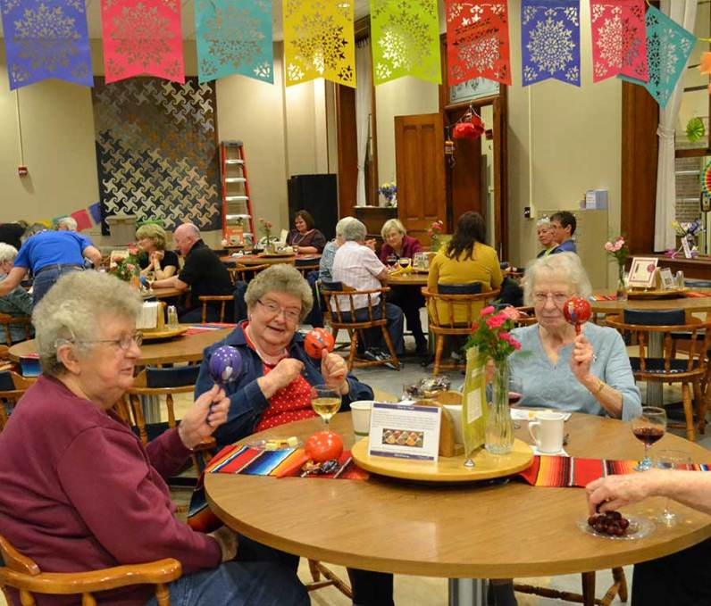 From left, Sisters of Providence Ruth Ellen Doane, Kathleen Kelly and Mary Lee Mettler enjoy the maracas during the social time at the Providence Associate retreat.