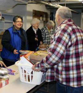 Then-postulant Joni Luna in her first year after coming to the Sisters of Providence volunteers distributing food at Providence Food Pantry in West Terre Haute.