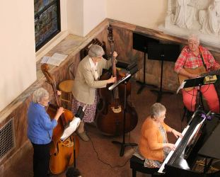 Contributing to the musical talent at the liturgy are from left, Sisters Nancy Bartasavich, Marie Paul Haas, Carolyn Bouchard and Providence Associate Karen Sagraves on piano.