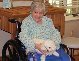 Sister Marian Ruth Johnson smiles broadly while Benny just relaxes.