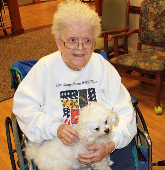 Sister Anita Bechert is the first one to get to hold Benny on this visit.