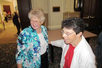 Sister Paula Modaff (right) congratulates newly re-elected General Officer Sister Jenny Howard. (Photo by Sister Joni Luna)
