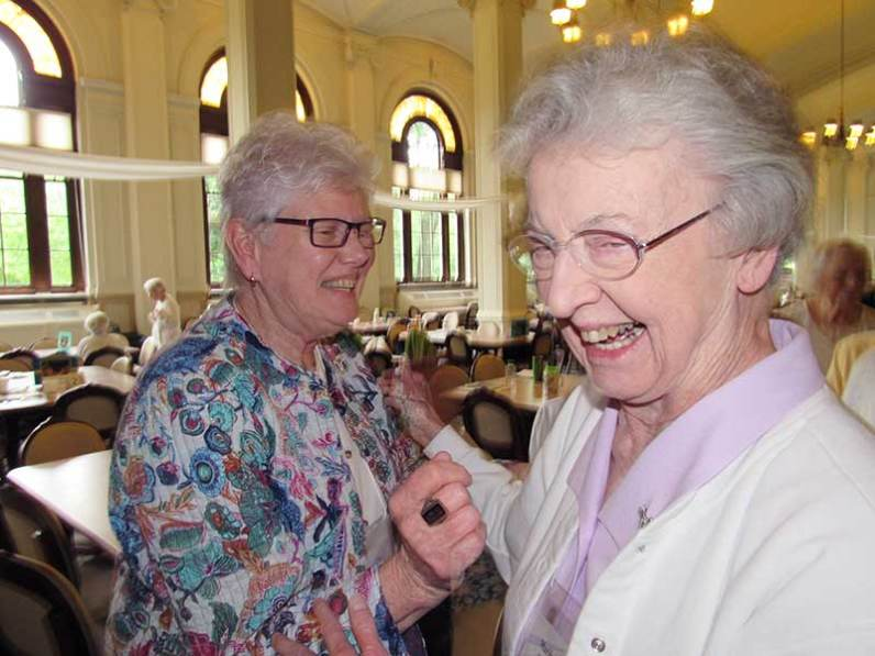Newly re-elected vicar Sister Lisa Stallings is greeted by Sister Marilyn Herber. (photo by Joni Luna)