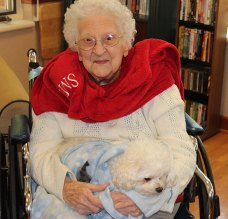 Sister Mary Esther swaddles Benny .