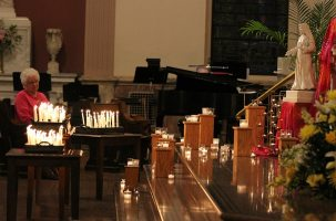 Sister Kay Manley and the display of candle light during the opening ritual for Chapter. (photo by Amy Miranda)