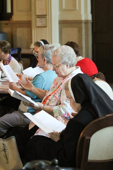Sisters Lawrence Ann Liston and Helen Therese Conway during a prayer time. (photo by Amy Miranda)