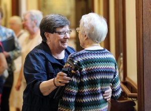 Love and home: Sister Janice Ostrowski shows her love for Sister Margaret Wilson in her excited greeting to see her again when Sister Janice was recently home at the Woods for a gathering.