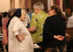 Sister Marian Brady, left , greets Providence Associate Teresa Clark before the opening ceremony for General Chapter.