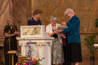 General officers present Sister Denise Wilkinson with an engraved brick to be placed in front of the Church of Immaculate Conception