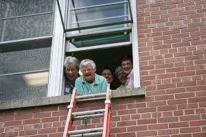 Sister Denise Wilkinson (front) with Sister Nancy Reynolds (back, from left) Sister Paula Damiano, Sister Marsha Speth and Sister Jane Marie Osterholt (RIP) in a photo from 2011 when the General Council got locked in a room inside Owens Hall.