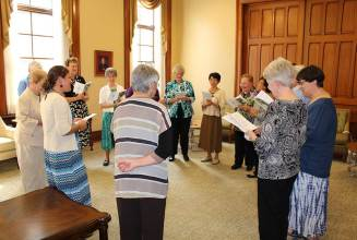 The group gathers and prays with and for Emily as she is welcomed to the Congregation.